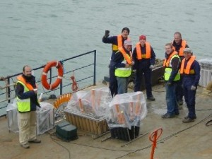 Firework Display Technicians launch fireworks from a barge